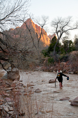 Jeff rescues the hat in the Virgin River- Zion National Park, Utah