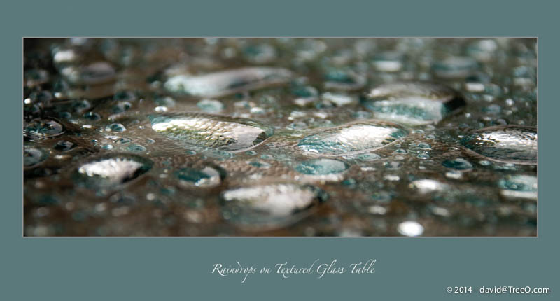 Raindrops on Textured Glass Table
