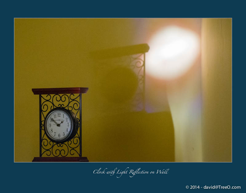 Clock with Light Reflection on Wall