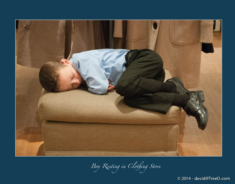 Boy Resting in Clothing Store